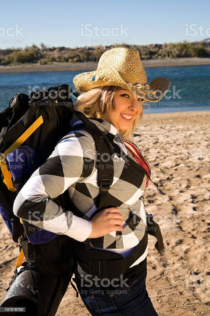 Backpacking along the river stock photo
