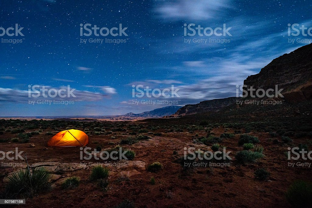 Backpacking and Camping Below the Kaiparowits Plateau stock photo
