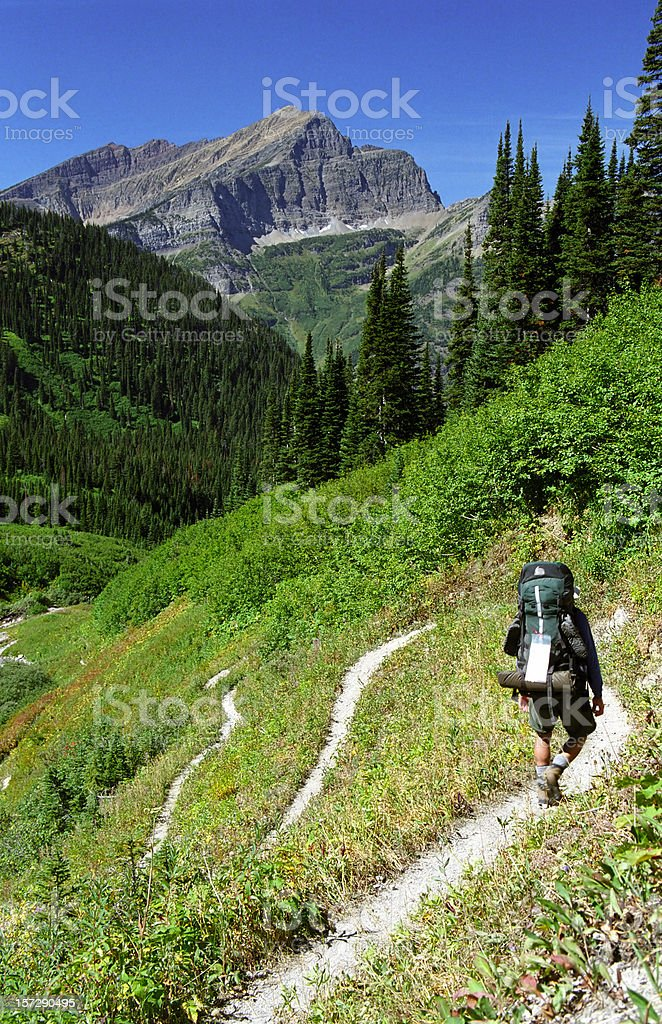 Backpacking Down Winding Trail royalty-free stock photo