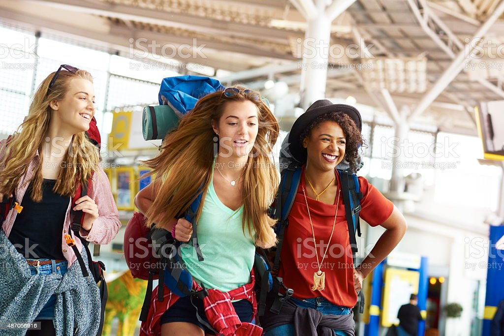 Backpacking friends undertake the next part of their journey stock photo