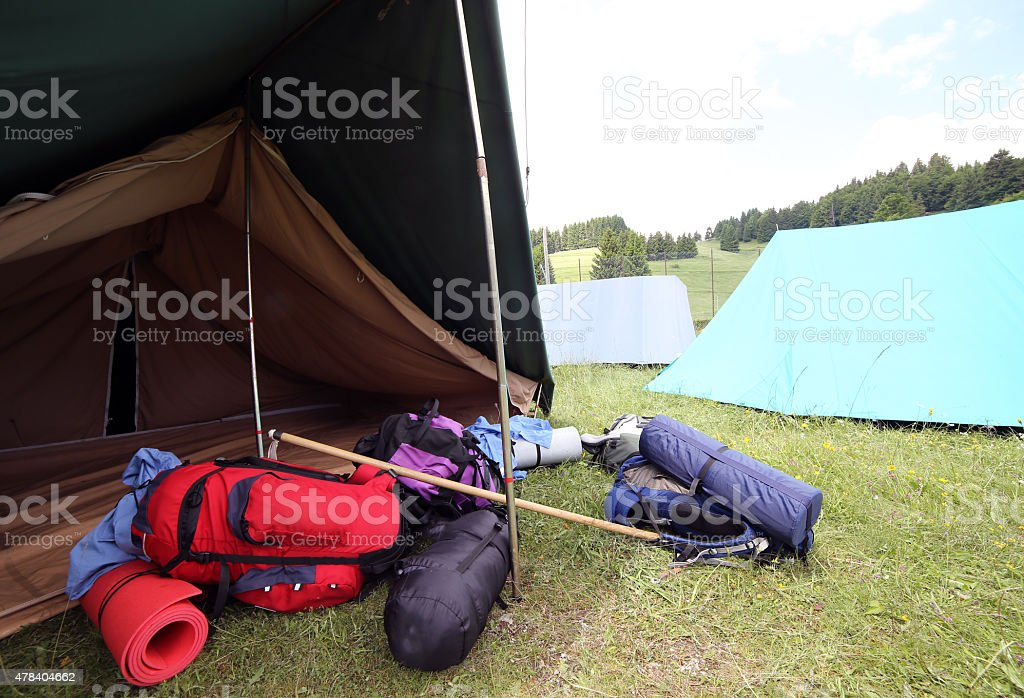 backpacks and sleeping bags outside the camping tent stock photo