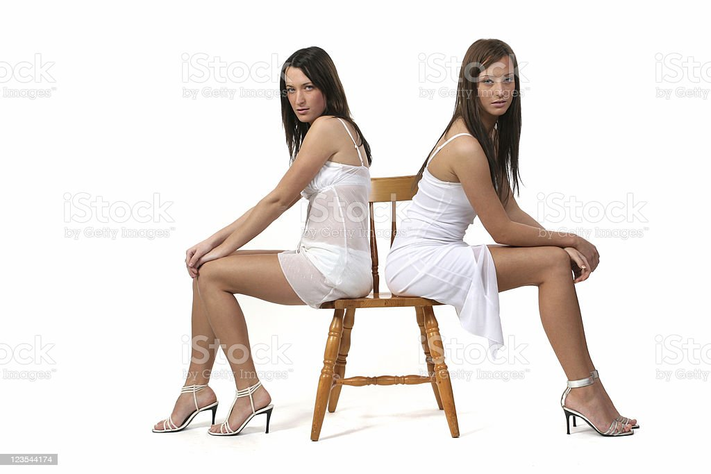 Backs on a wooden chair royalty-free stock photo