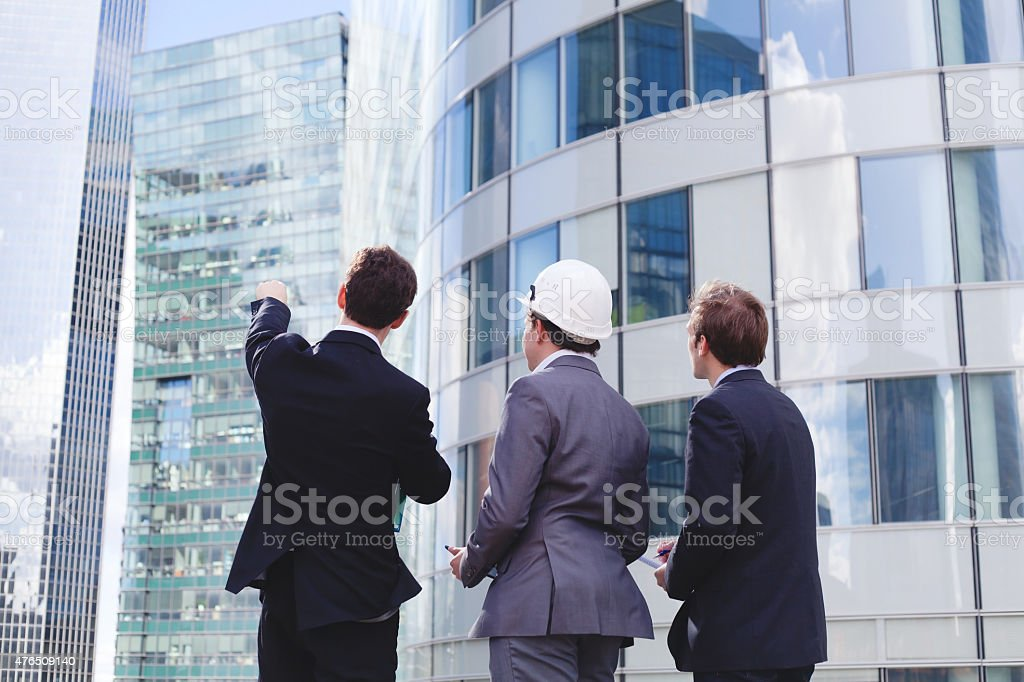 backs on group of business men stock photo