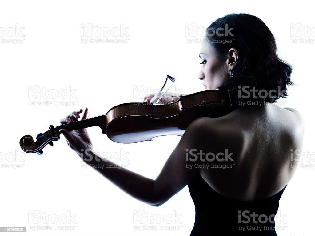 Backside of a female violinist playing her violin stock photo