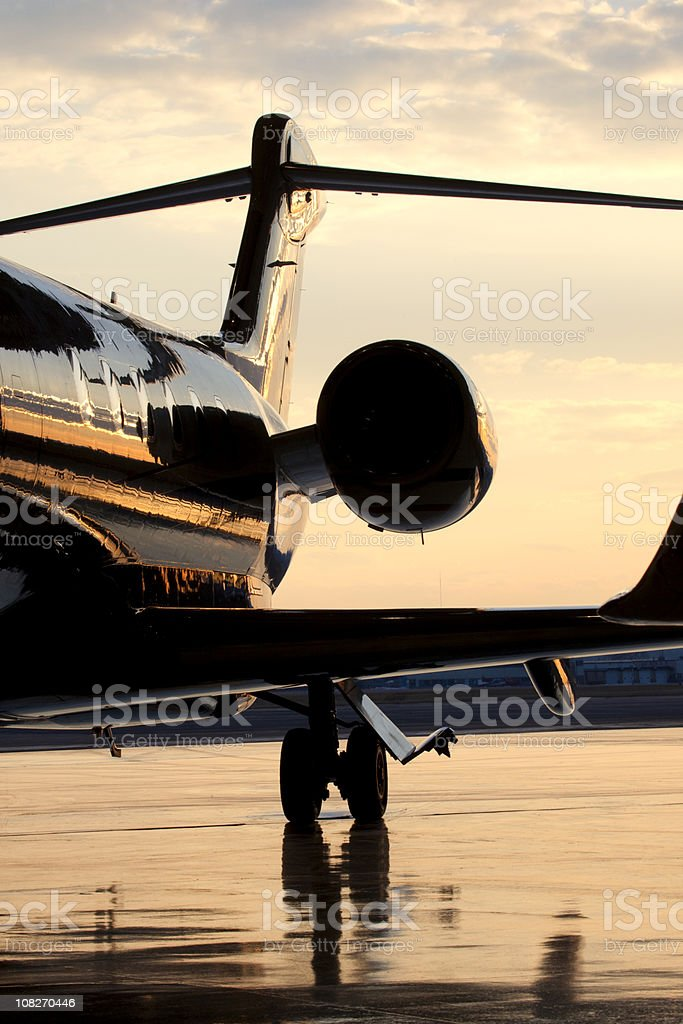 Backside of Private Jet on Tarmac at Dusk stock photo
