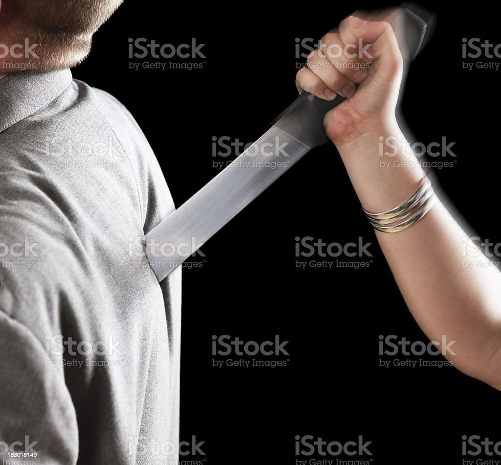 Backstabbing! Man receives thrust in the back by violent woman royalty-free stock photo