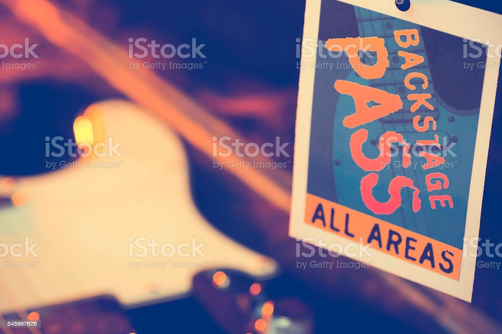 Backstage pass with a guitar. stock photo