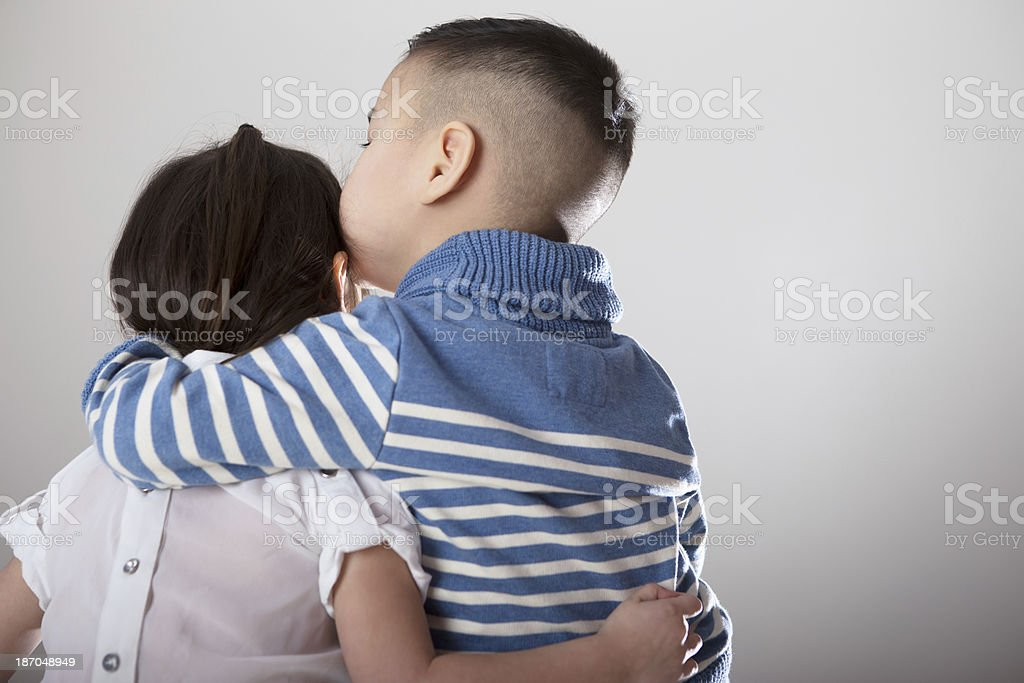 Backview Asian girl and boy hugging royalty-free stock photo