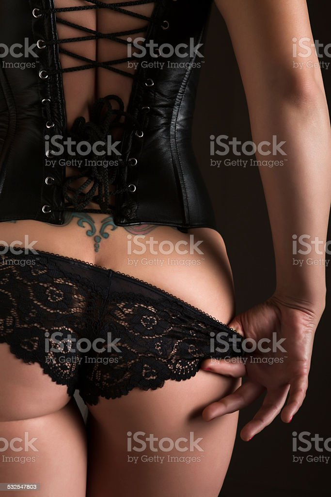 Backview of sexy woman in corset stock photo
