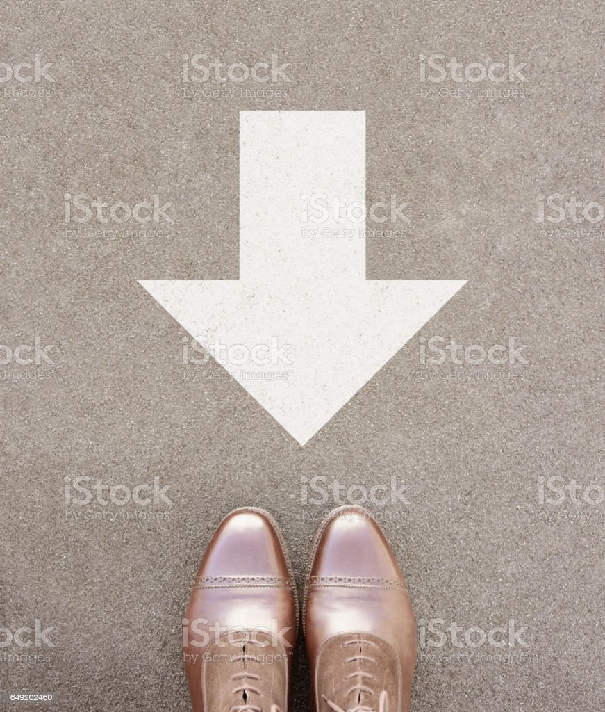 Backwards, against. Big arrow and perfect kept different business shoes. stock photo