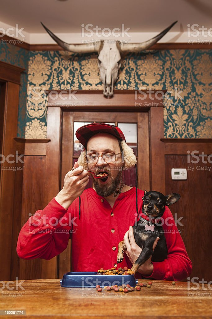 Backwoods Man Eats his Dog's Kibble at Kitchen Table 4 stock photo