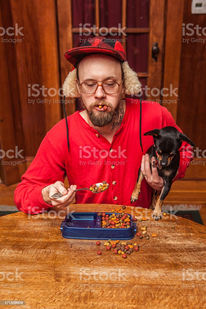Backwoods Man Eats his Dog's Kibble at Kitchen Table 5 stock photo