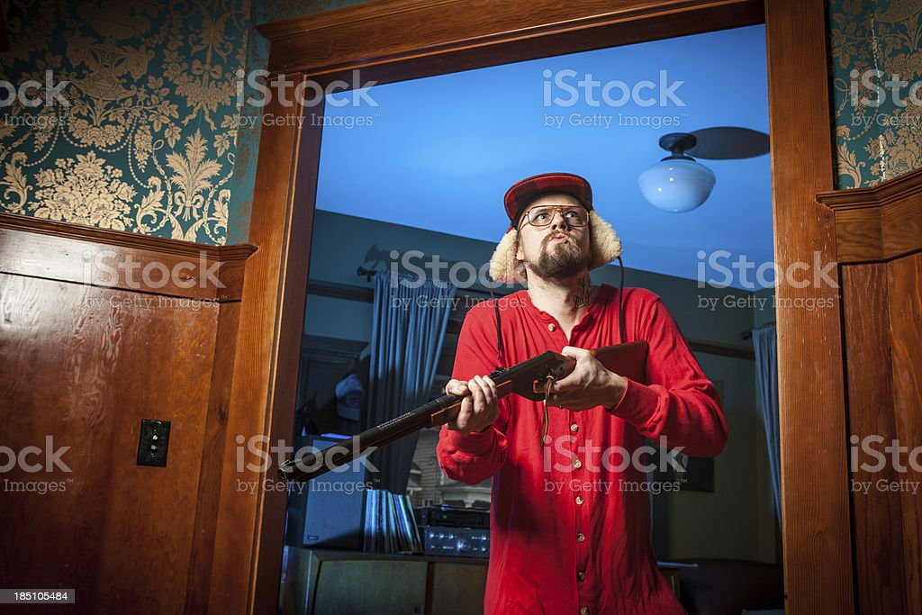 Backwoods Man in Doorway with Shotgun Glaring Upwards 1 stock photo