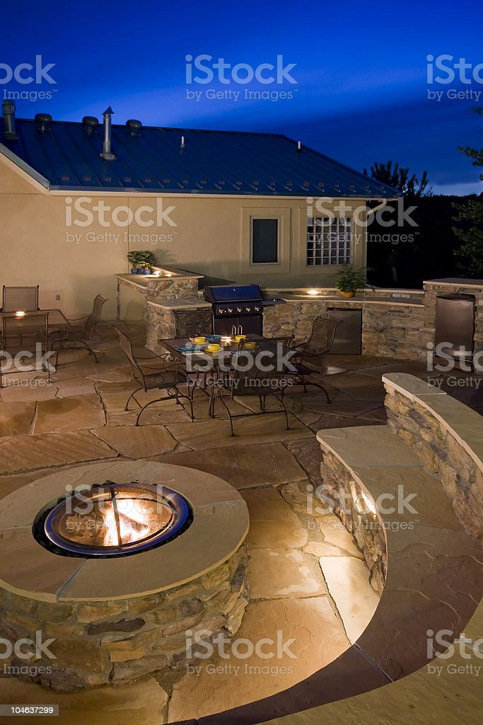 Backyard at dusk with fire pit stock photo