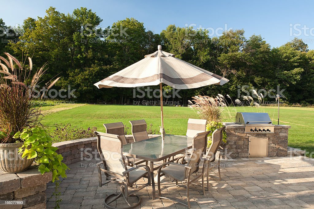Backyard barbeque with table and grill. royalty-free stock photo