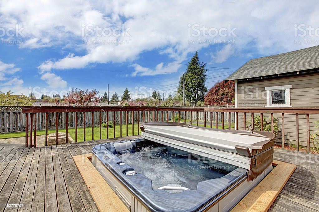 Backyard deck with jacuzzi stock photo