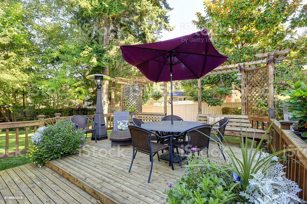 Backyard patio area with outdoor wicker furniture. Northwest, USA