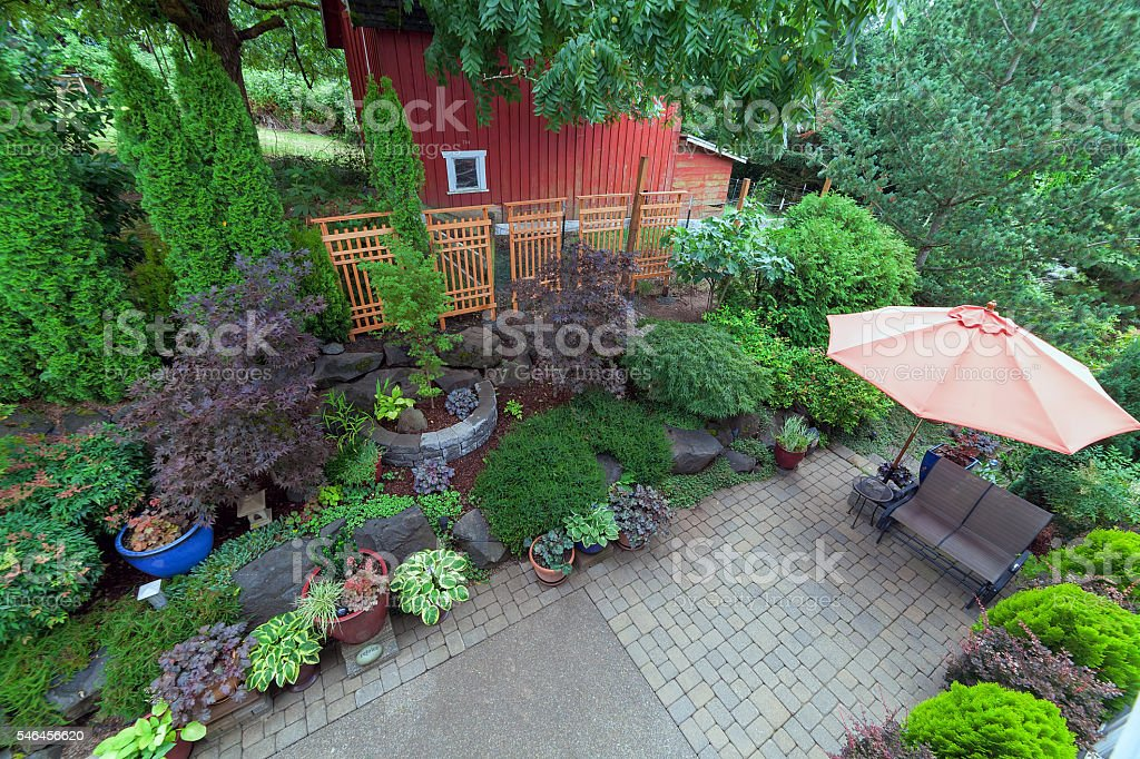 Backyard Patio Landscaping with Red Barn Overview stock photo