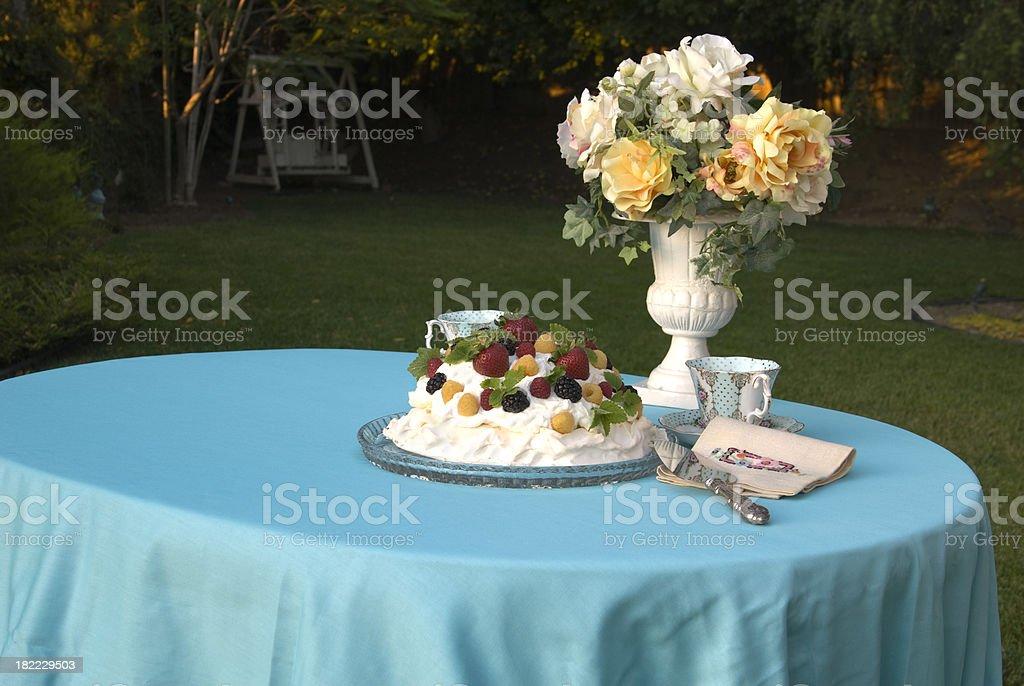 Backyard Picnic Table, Berry Fruit Pavlova Dessert Cake & Afternoon Tea royalty-free stock photo