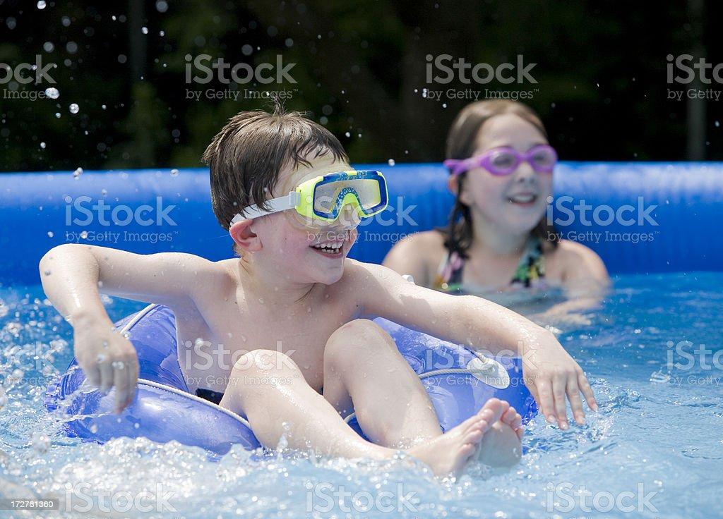 Backyard pool fun stock photo