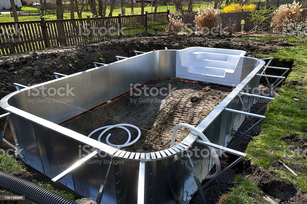 Backyard Swimming Pool Construction stock photo