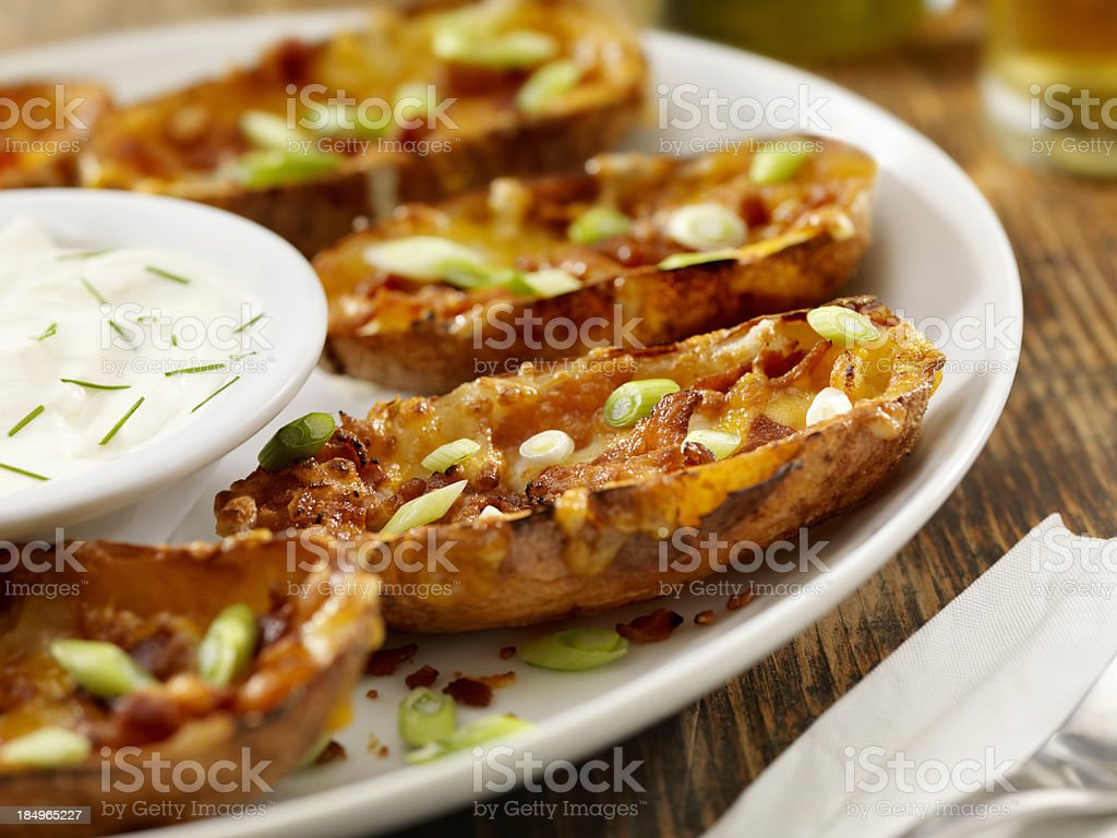 Bacon and Cheddar Stuffed Potato Skins stock photo