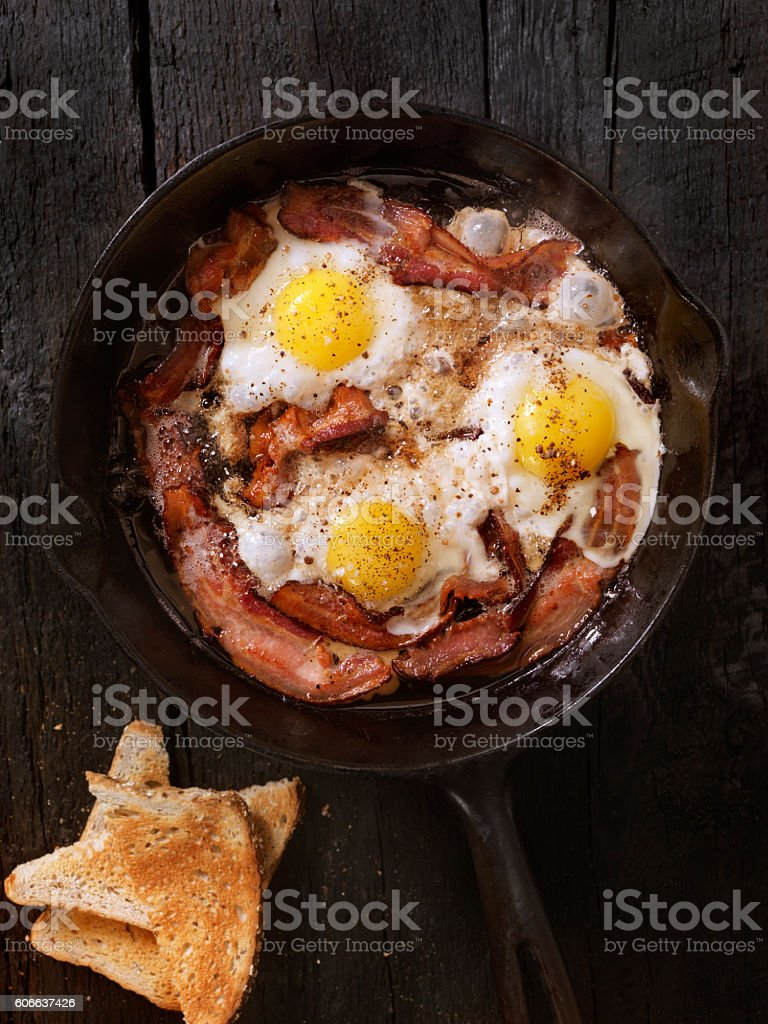 Bacon and Eggs Frying stock photo