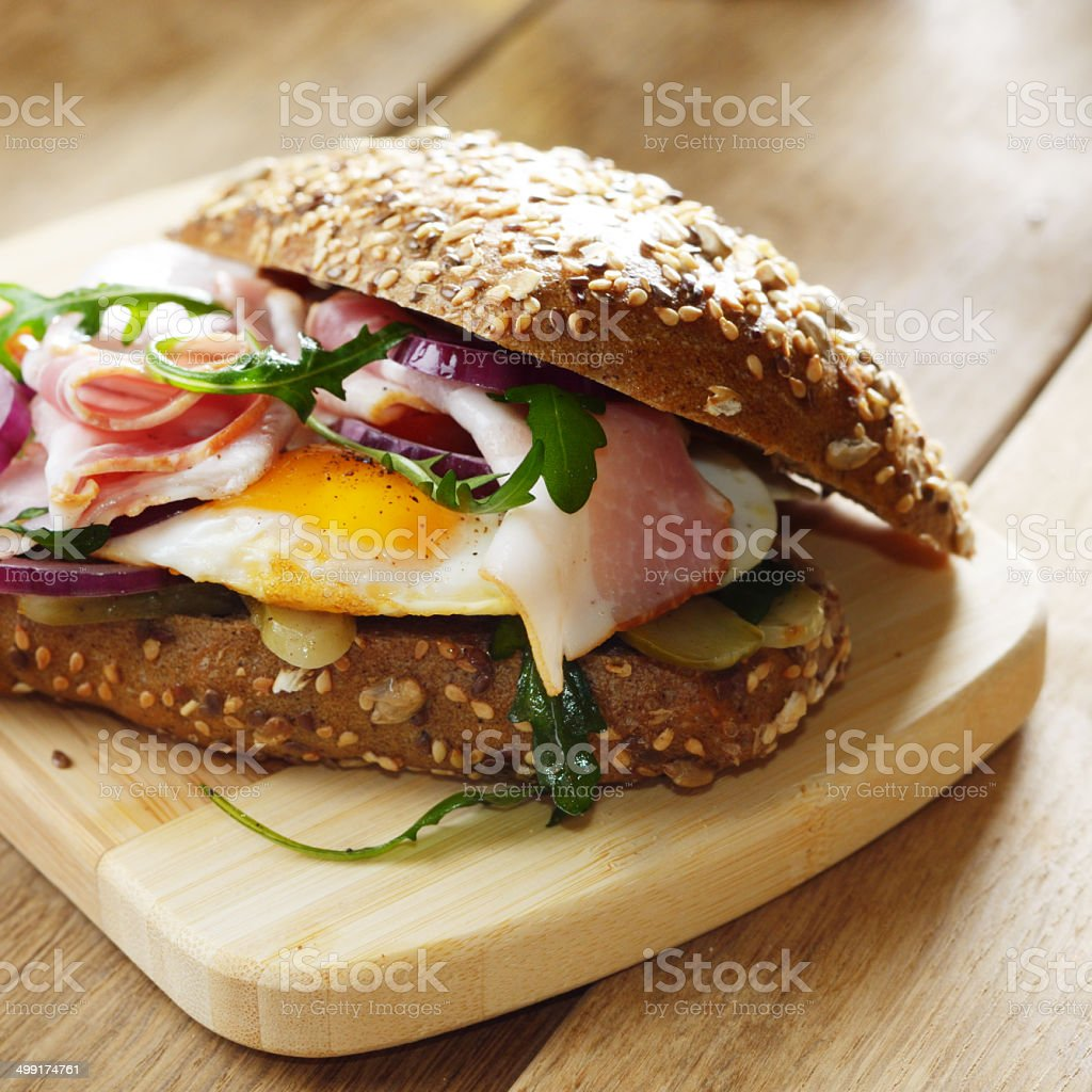 Bacon and fried eggs sandwich stock photo