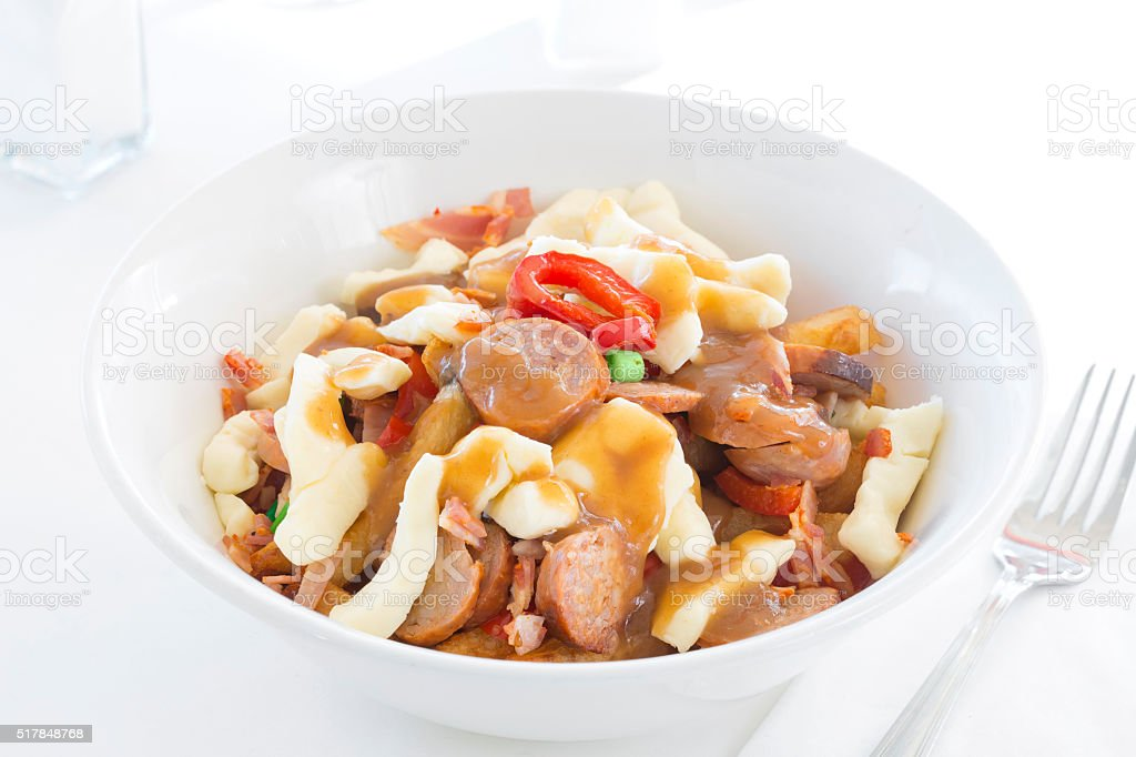 Bacon and Sausage Poutine – Quebec Classic stock photo