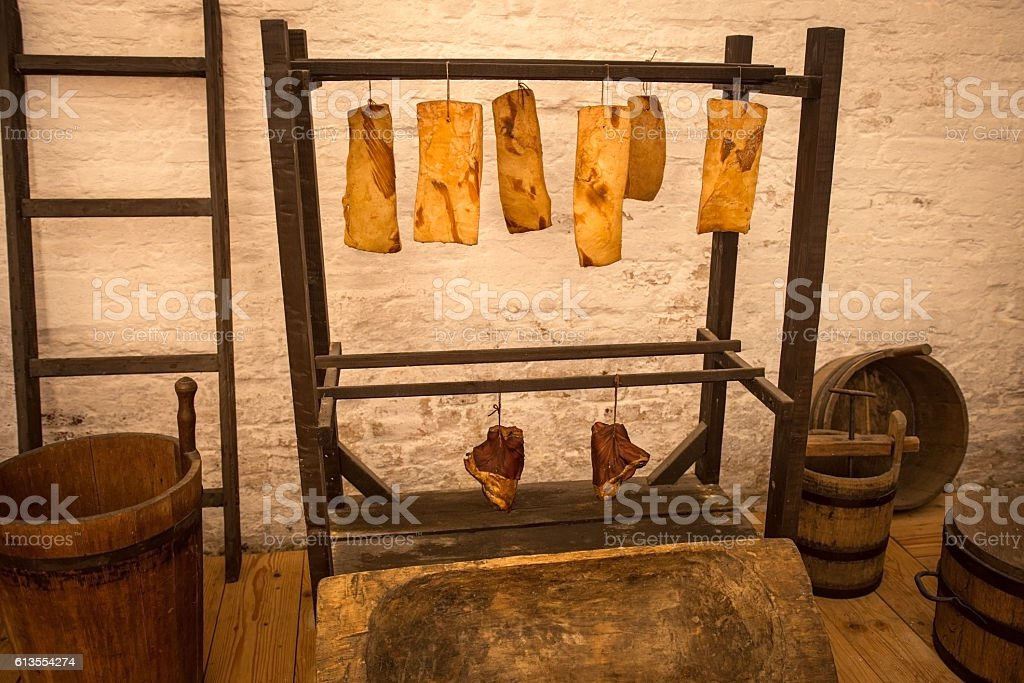 Bacon and smoked pork knuckle in traditional pantry stock photo