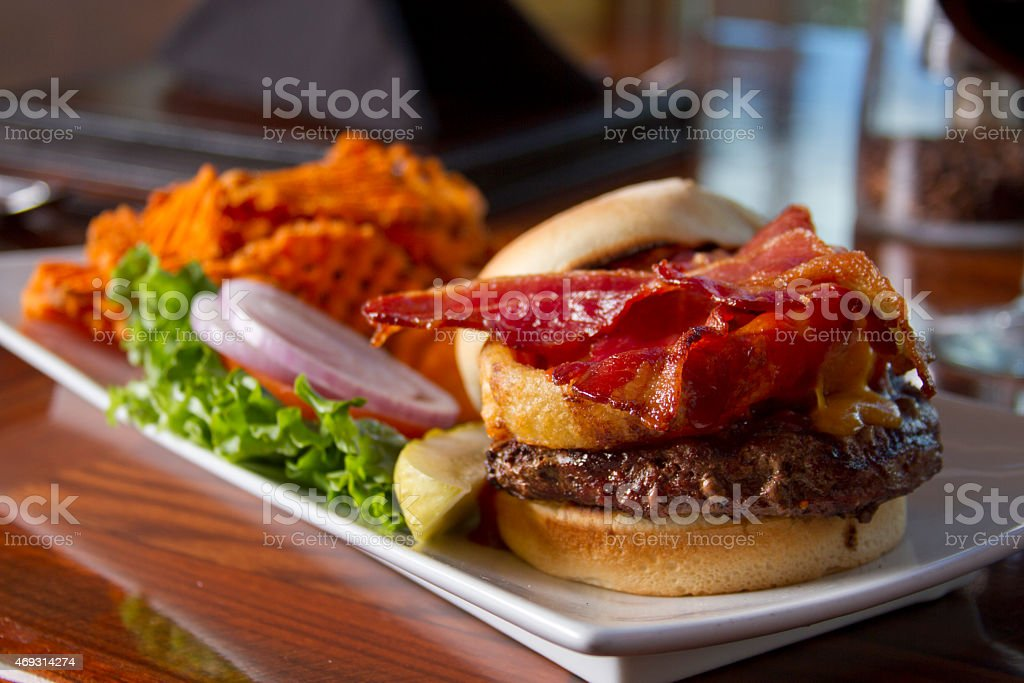 Bacon Burger with Sweet Potato Waffle Fries stock photo