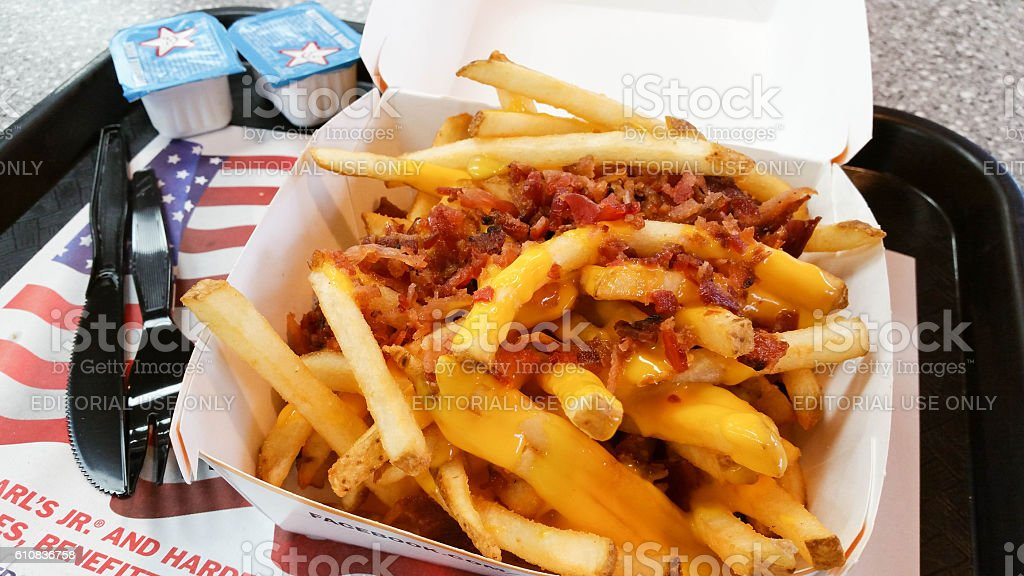 Bacon Cheese Fries with Ranch Dipping Sauce at Carl's Jr. stock photo