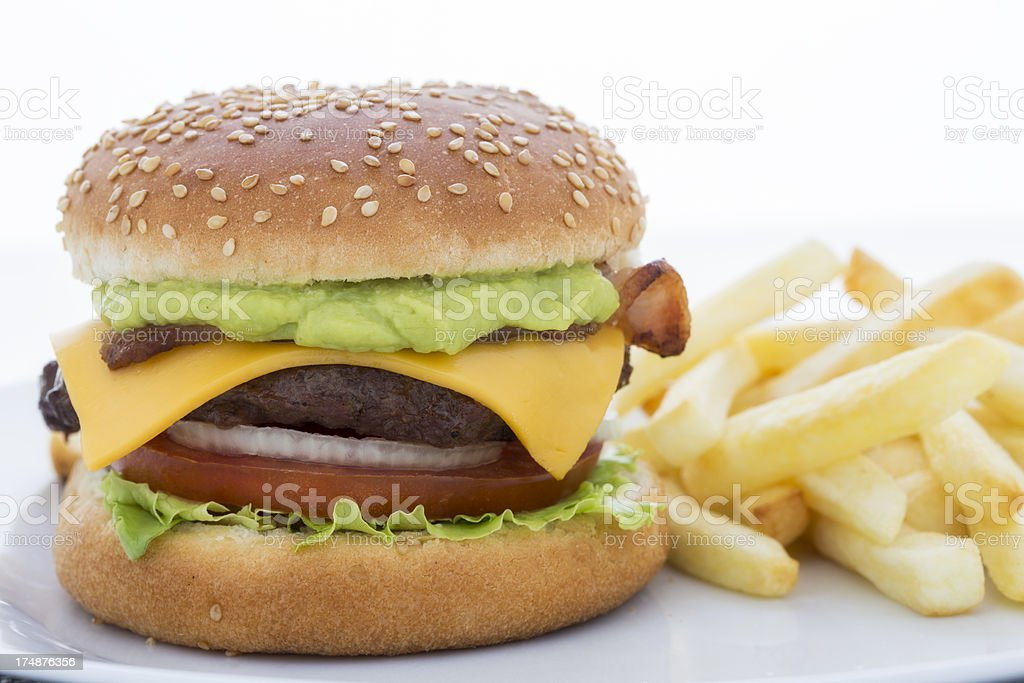 Bacon, cheese, guacamole burger with chips stock photo