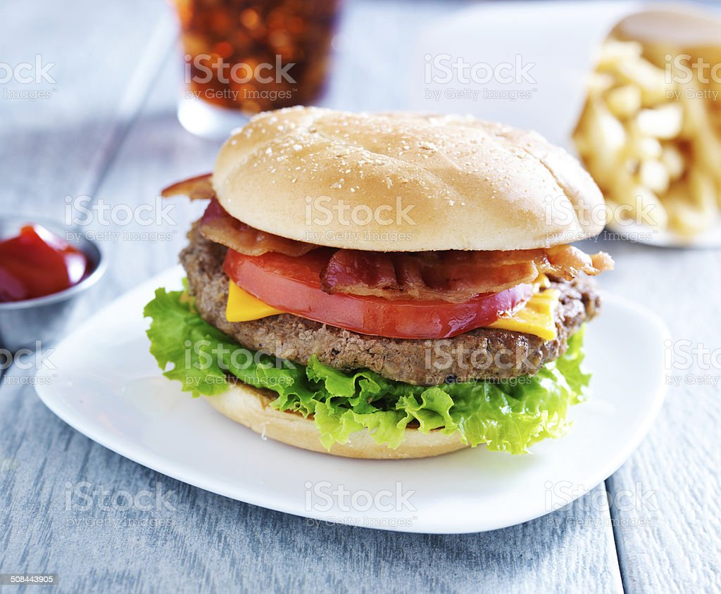 bacon cheeseburger meal with cola and fries stock photo
