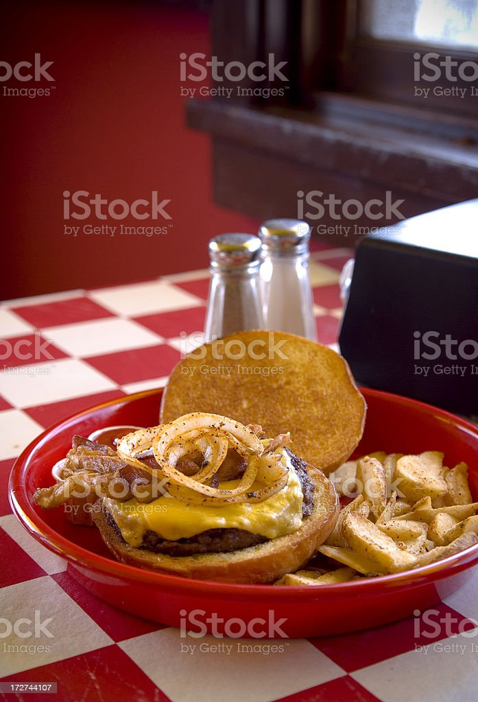 Bacon Cheeseburger with Grilled Onions royalty-free stock photo