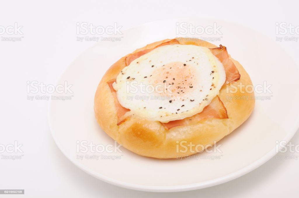bacon egg bread on plate on white background stock photo