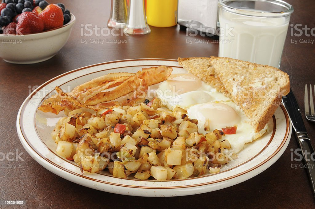 Bacon eggs and hash browns for breakfast stock photo