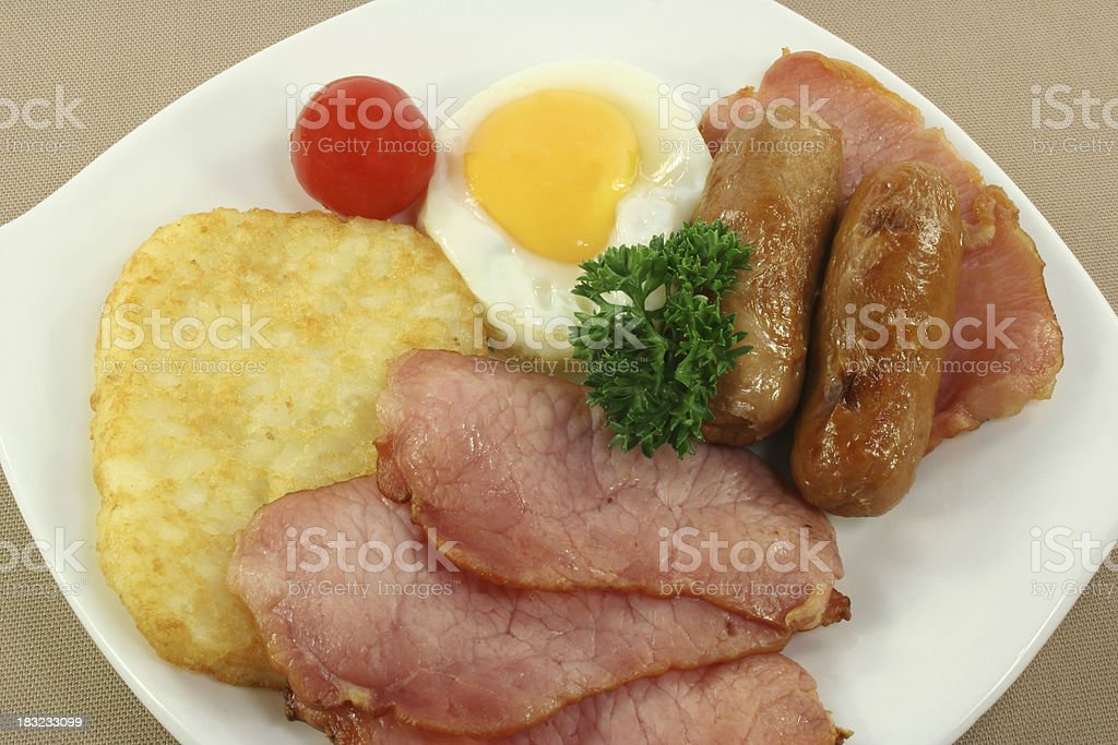 bacon, eggs, hash browns and sausages royalty-free stock photo