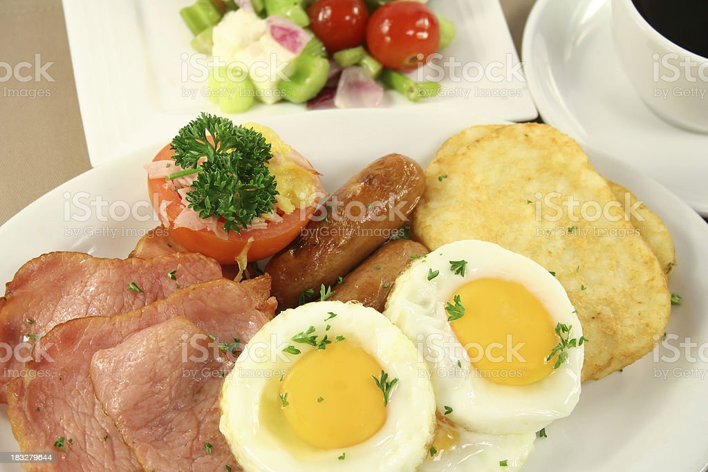 bacon eggs hashbrowns, tomato, sausages royalty-free stock photo