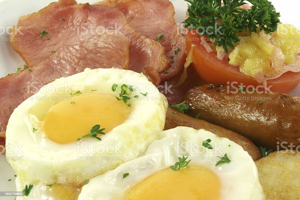 bacon eggs sausages and tomato royalty-free stock photo