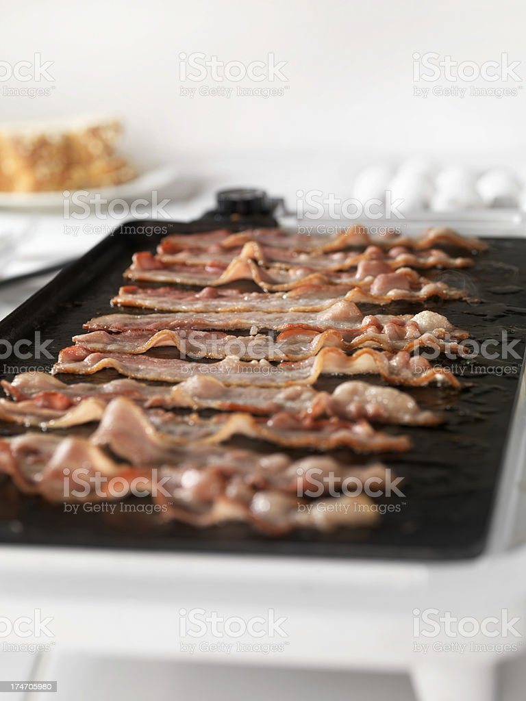 Bacon Frying on Fry Pan royalty-free stock photo