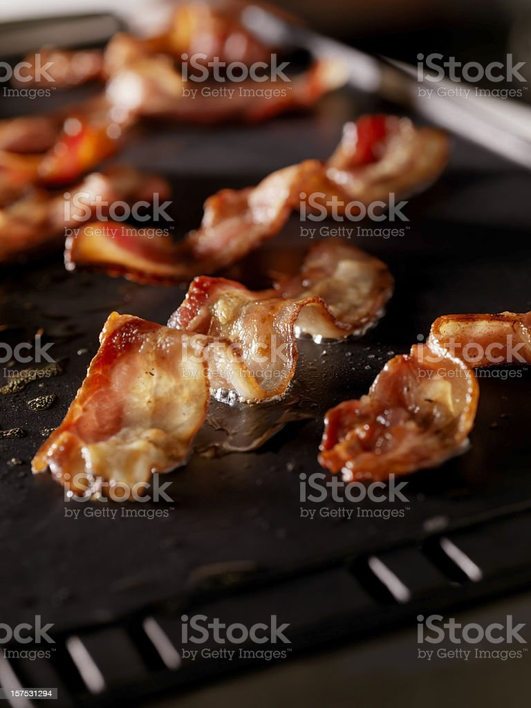Bacon Frying on The Grill royalty-free stock photo