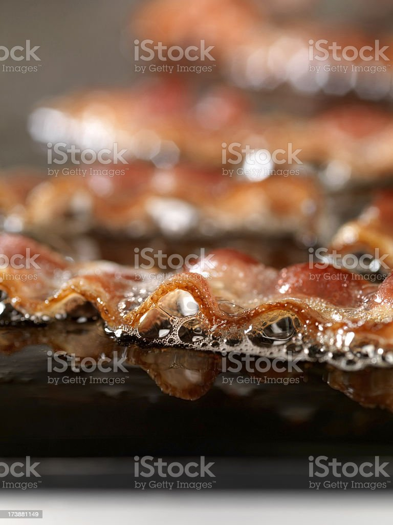 Bacon Frying on the Grill stock photo