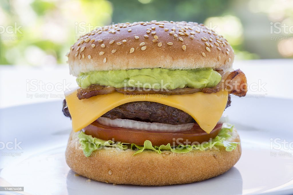 Bacon, guacamole and cheese burger stock photo