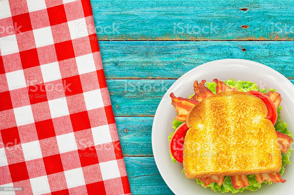 Bacon Lettuce and Tomato on Blue Picnic Table stock photo