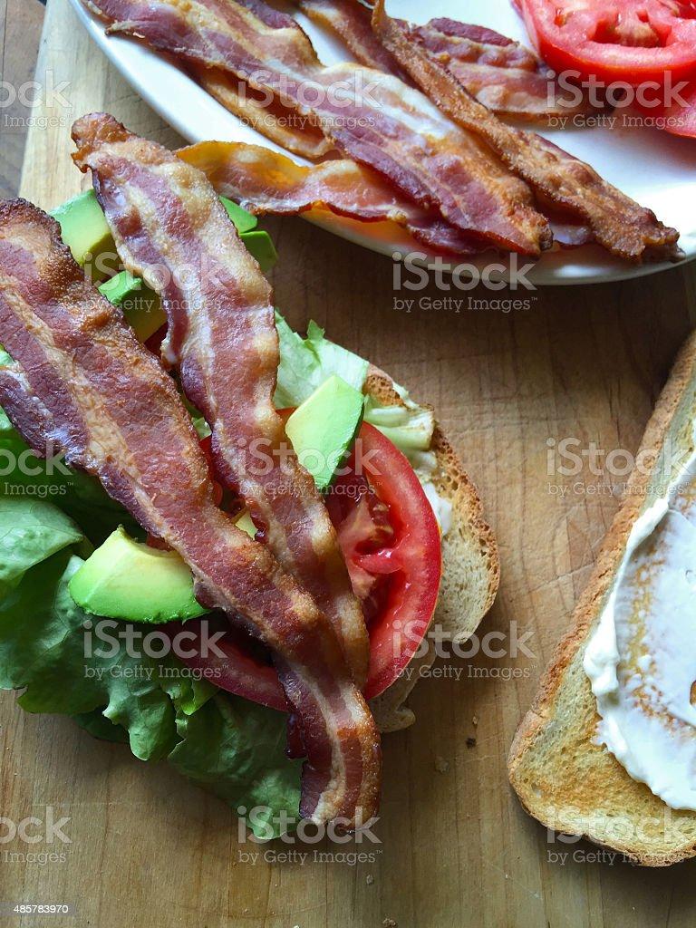 Bacon, lettuce tomato and avocado sandwich stock photo