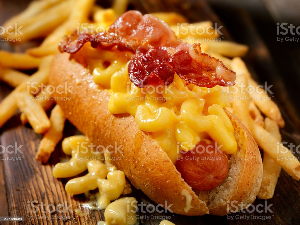 Bacon Mac and Cheese Dog with Fries stock photo