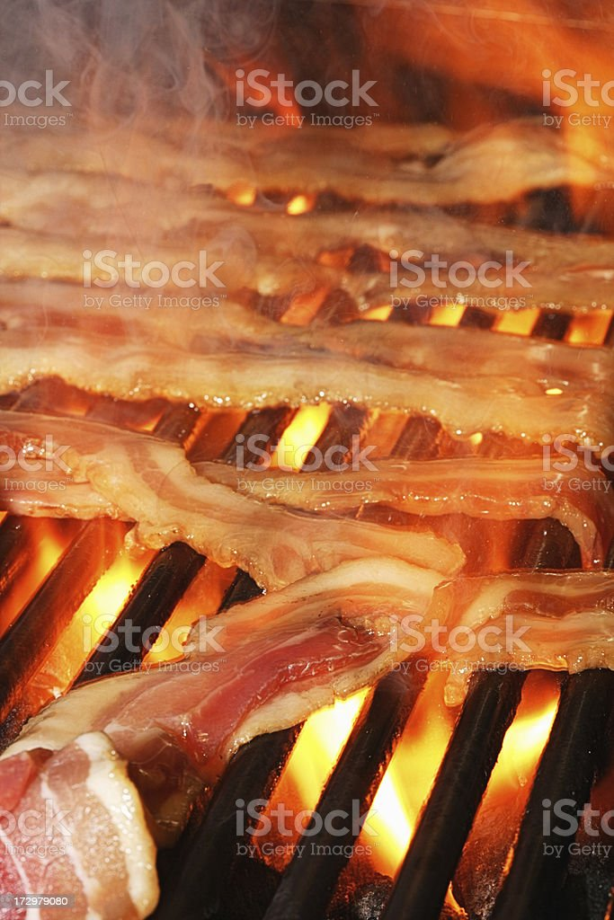 Bacon on the grill royalty-free stock photo