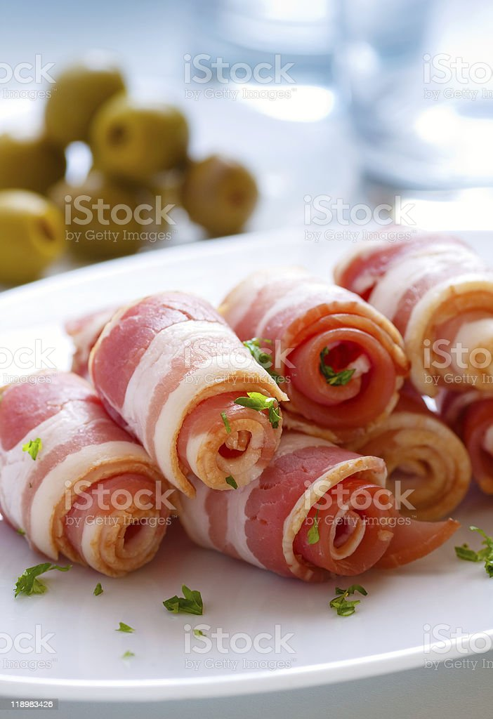 Bacon rolls piled on a white plate  royalty-free stock photo