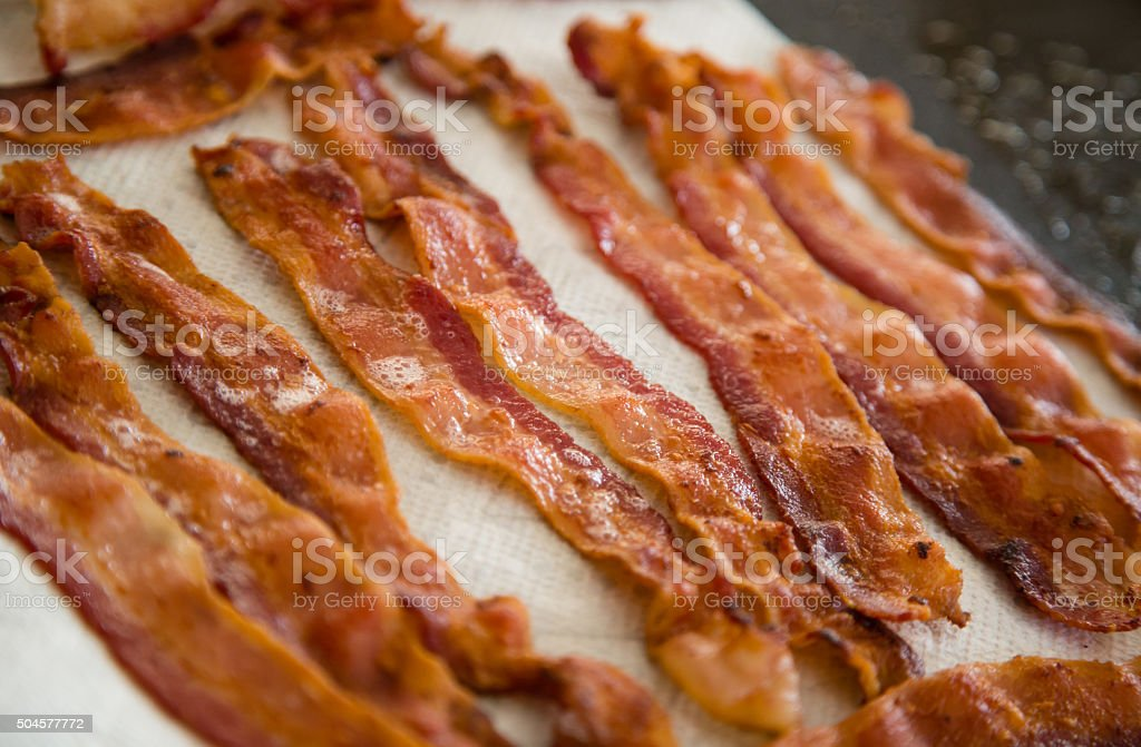 Bacon Slices Draining on a Paper Towel stock photo